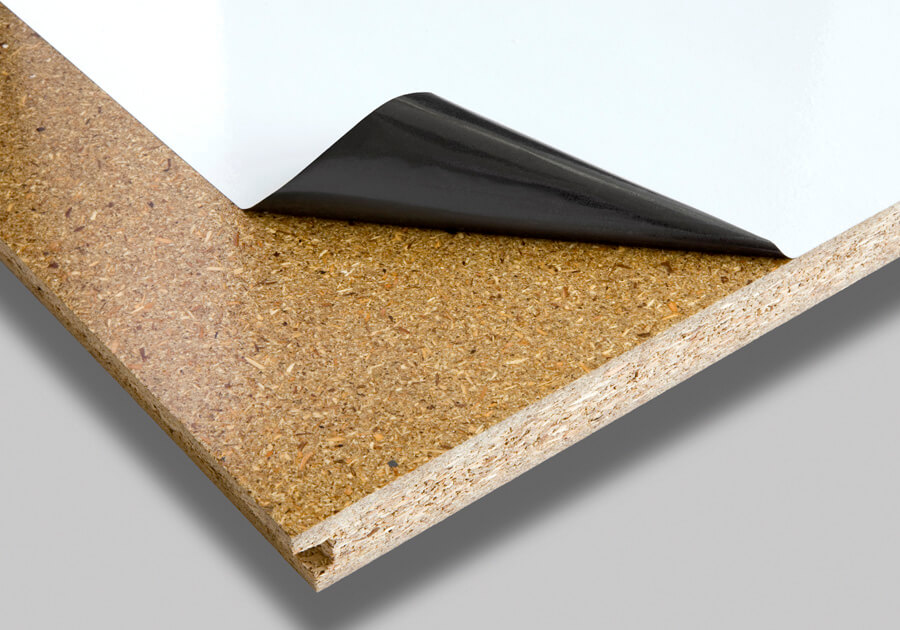 Coated particleboard with peel off protective film