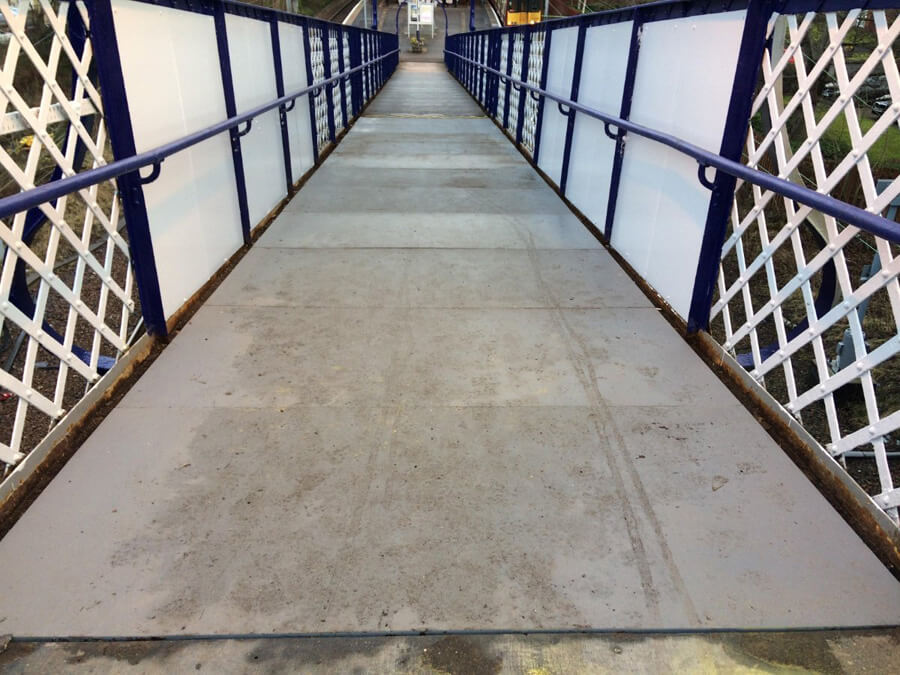 Slip resistant temporary overlay on public walkway
